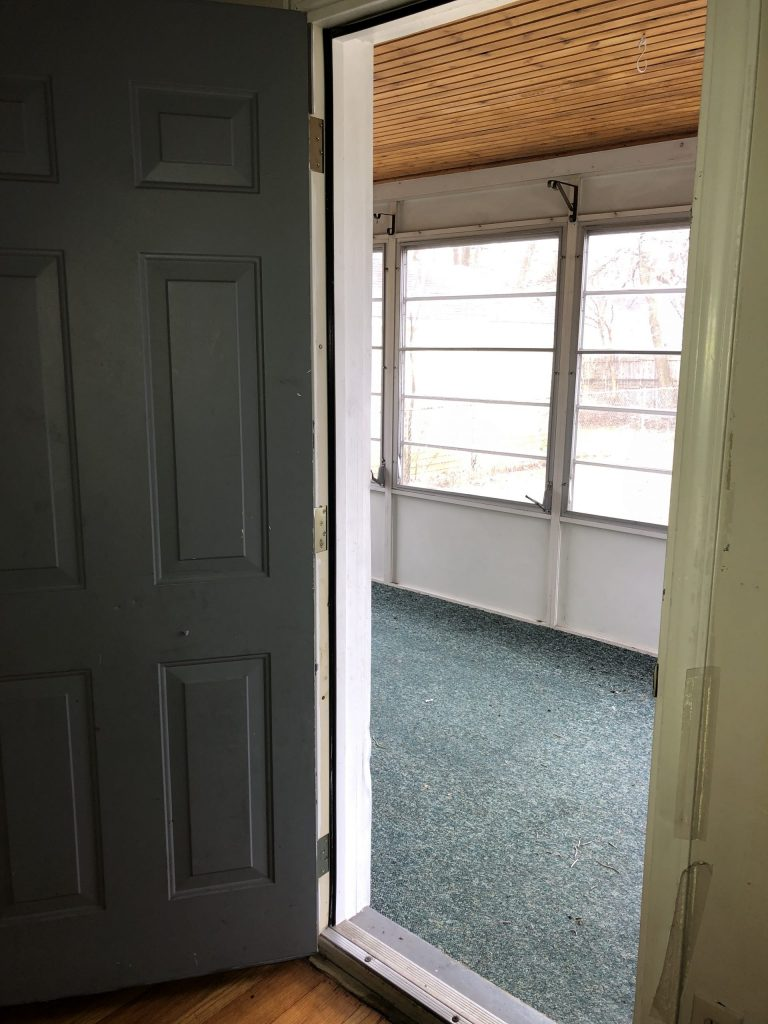 door opening up into large sunroom three seasons room