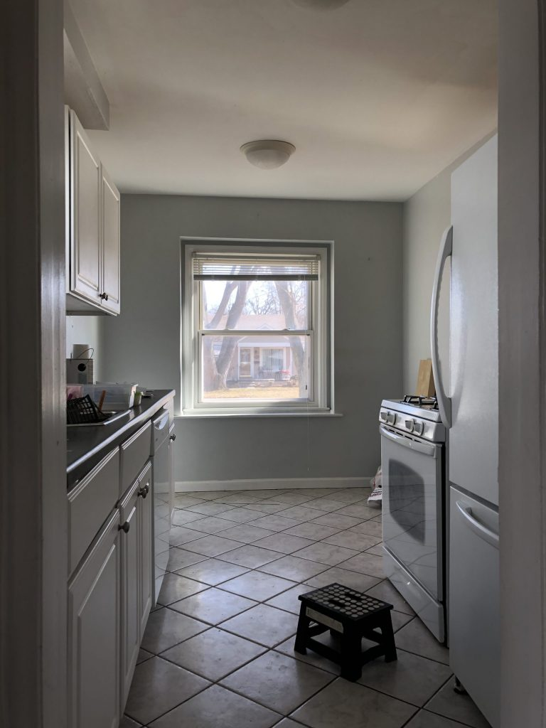 galley kitchen with large window