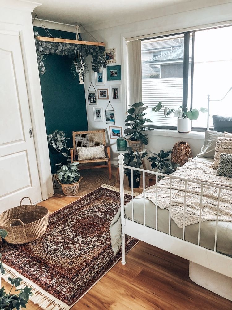 boho bohemian bedroom white with green accent wall and plants