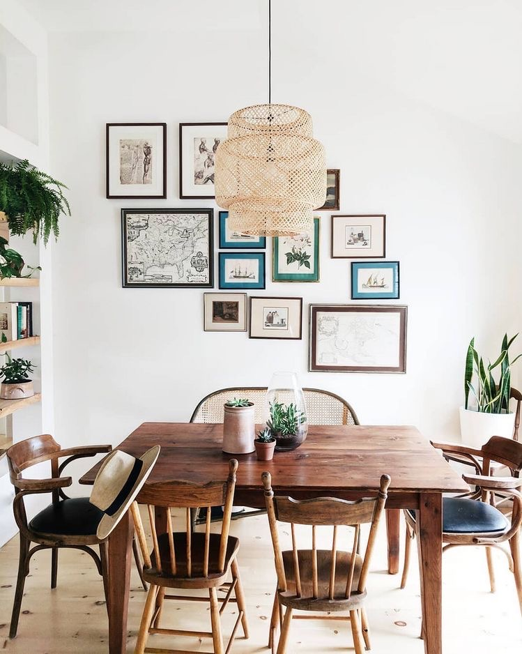 bright dining room with wood table, white walls, and a gallery wall