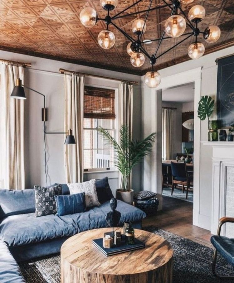 industrial living room historic with blue couch cozy