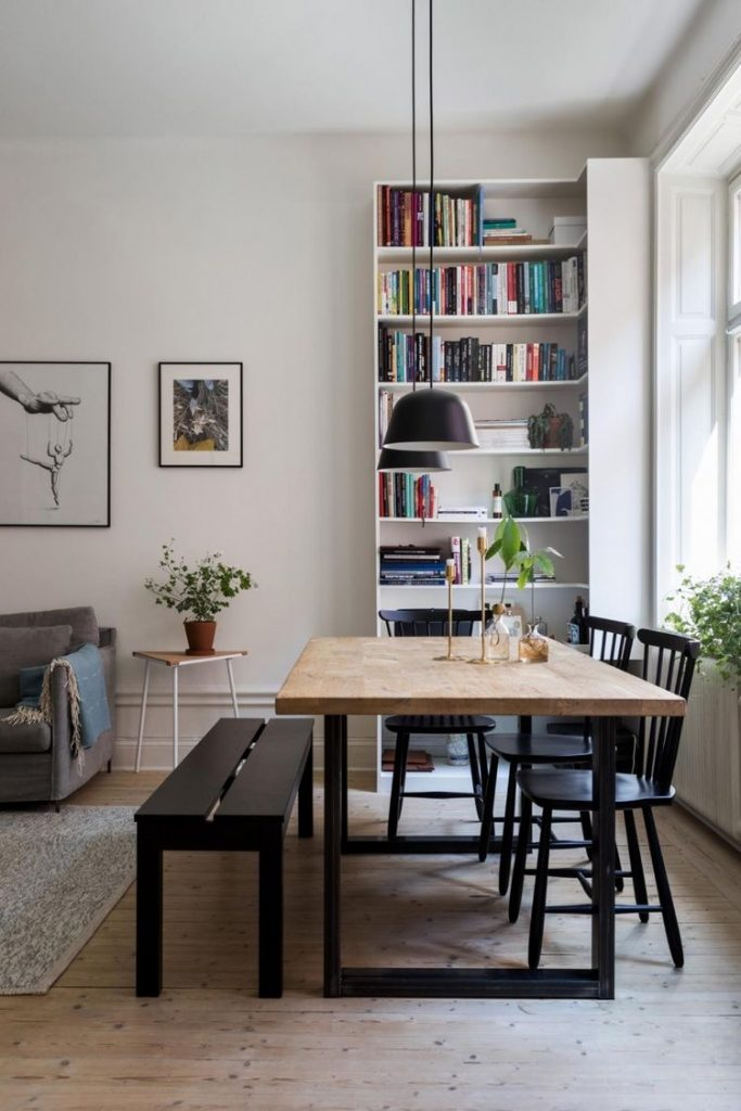 scandinavian simple natural dining room with gallery wall