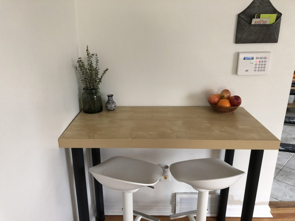 up close image of completed table with fruit bowl and plant