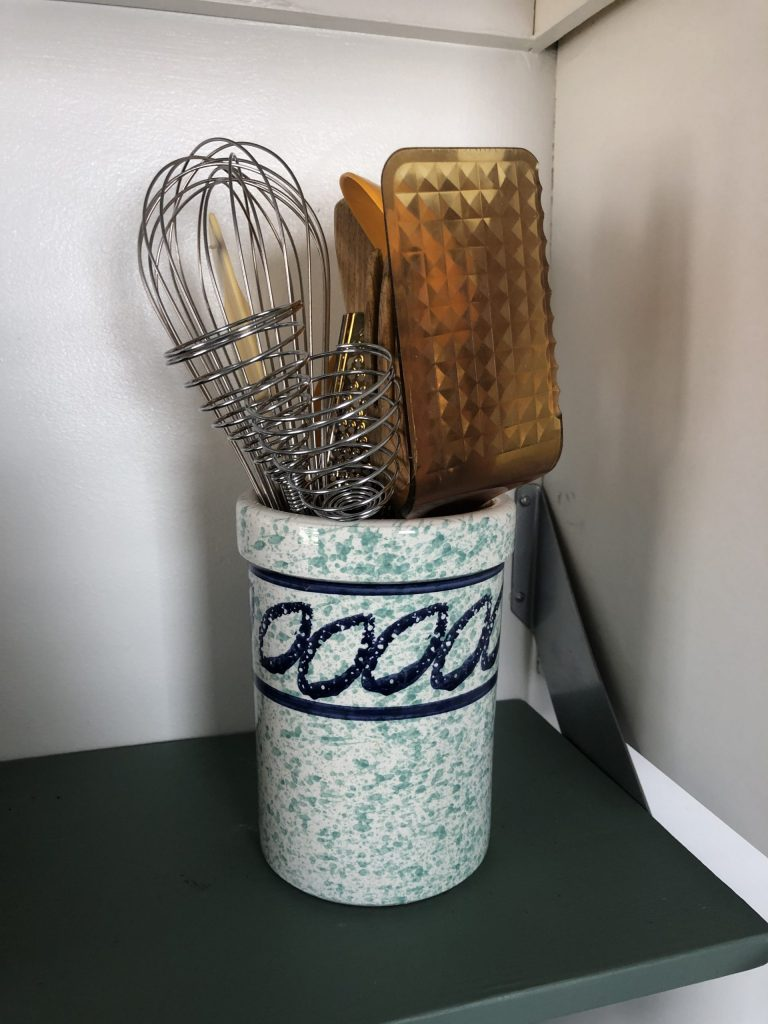 vintage canister of kitchen utensils, whisks