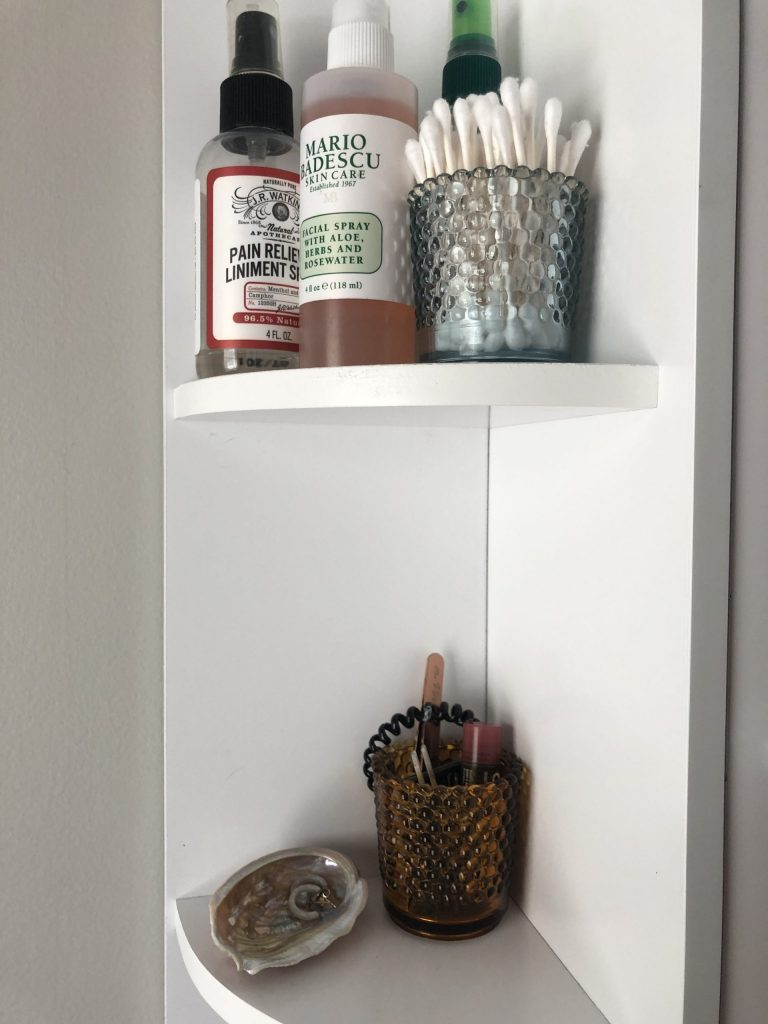 bathroom organization and storage using candle holders for small things