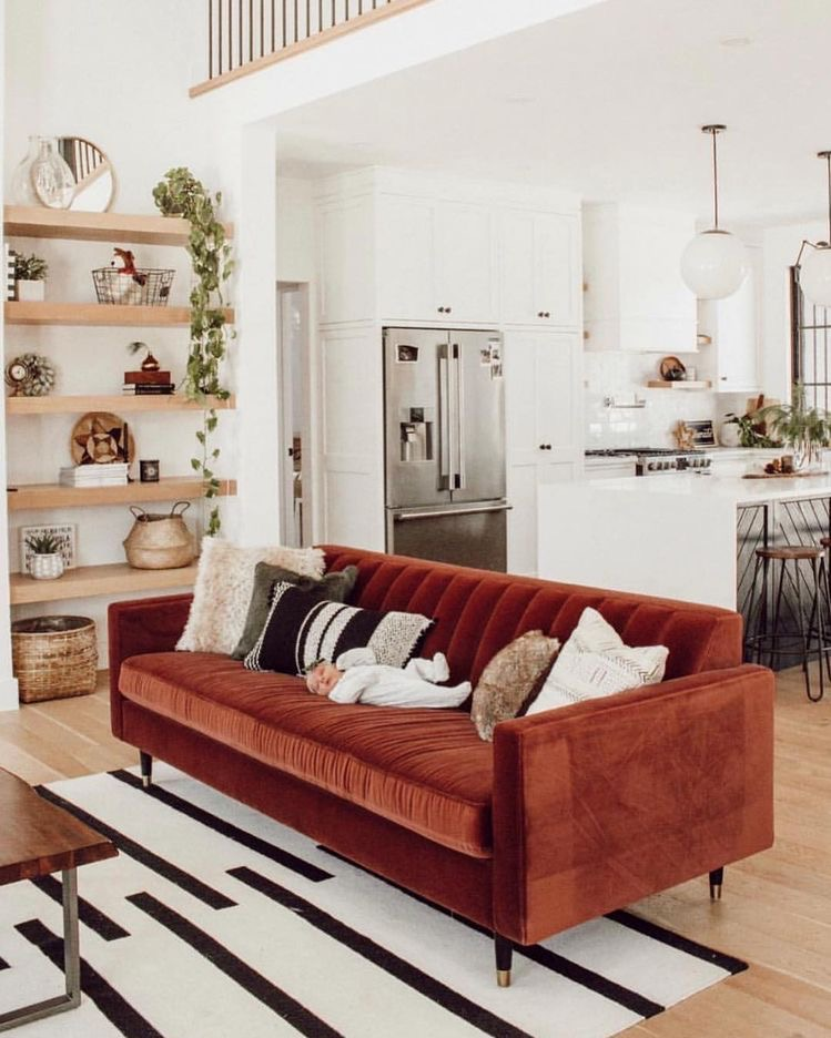 red couch velvet in a simple bright living room open concept