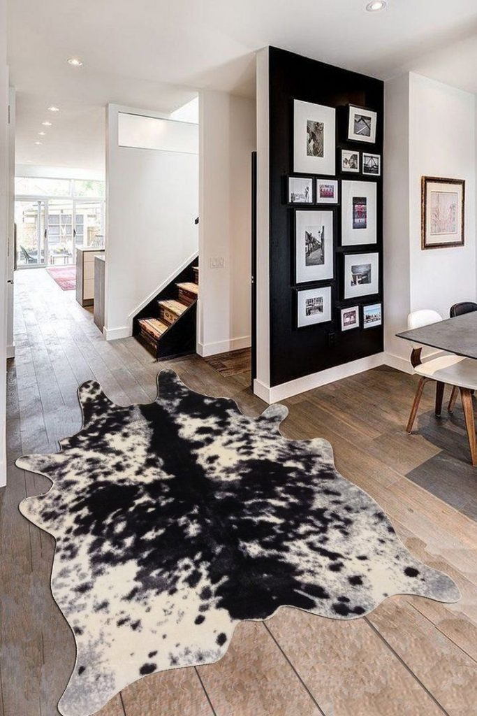 black and white faux cow hide rug black accent gallery wall