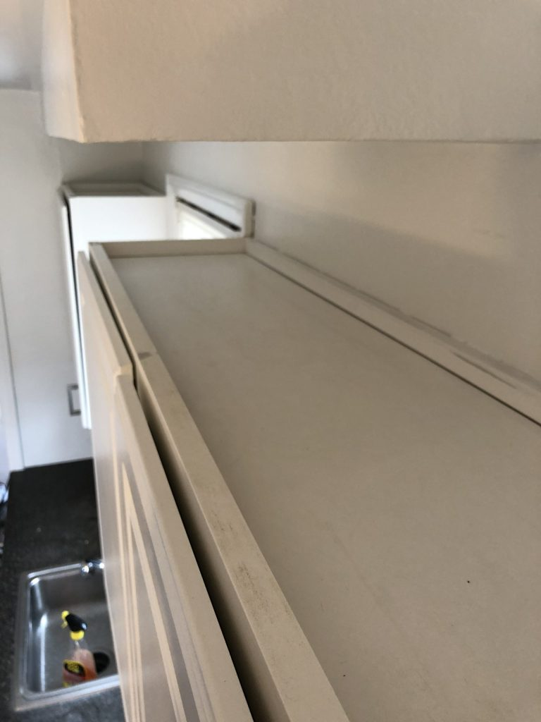 clean tops of kitchen cabinets