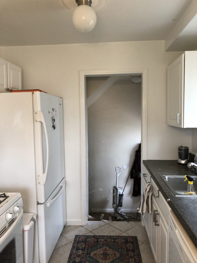 white empty wall in galley kitchen