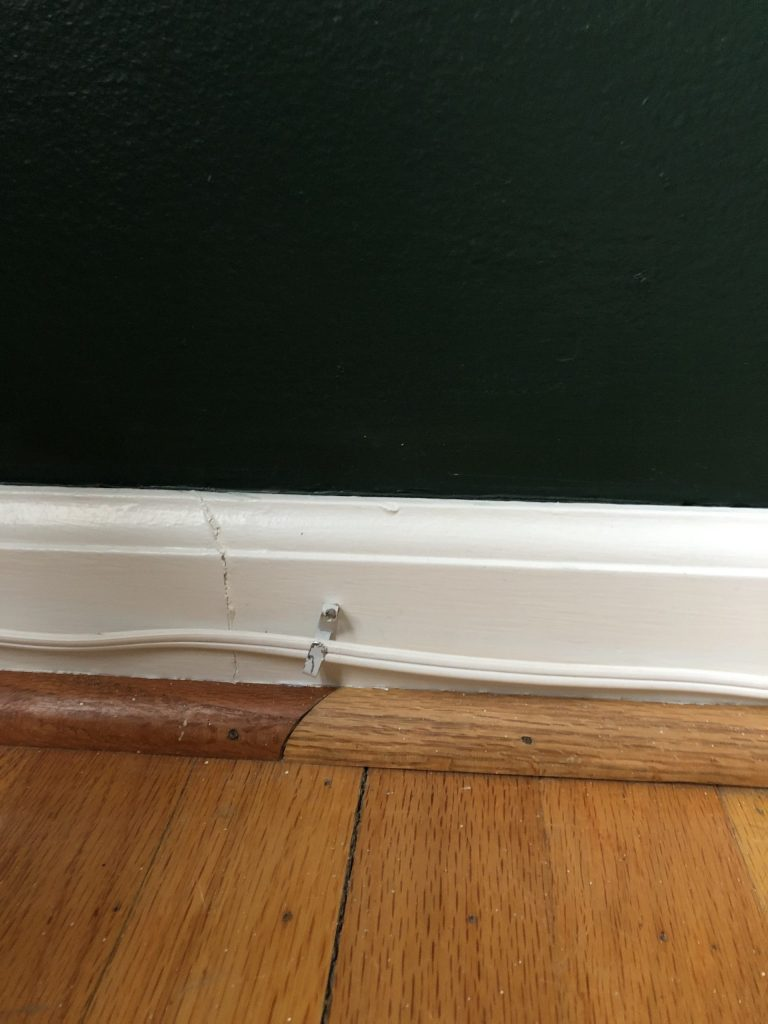 cords pinned to trim hidden
