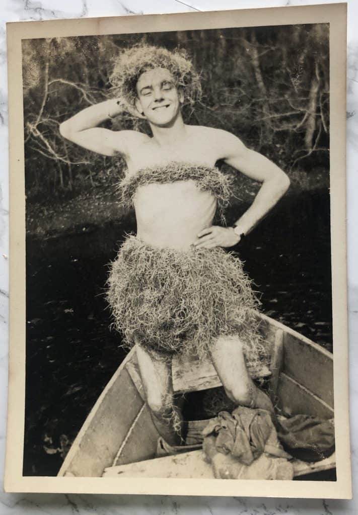 vintage photo man in hula skirt